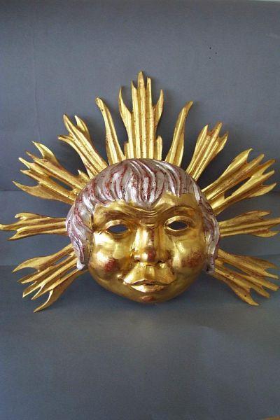 Sonne Maske gefaßt